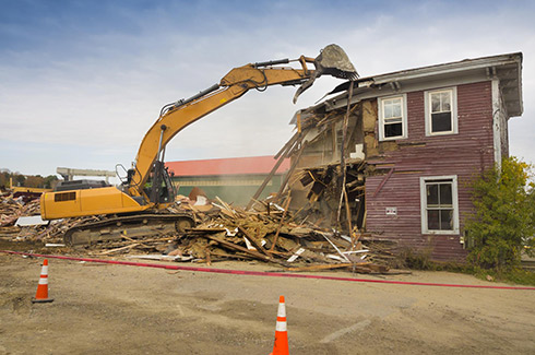 heavy equipment demolishing a building in alexandria va